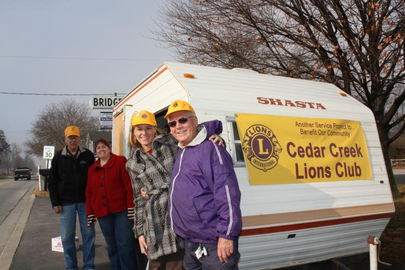 Dr. Laughlin participates in a Cedar Creek Lions Club project at Leo